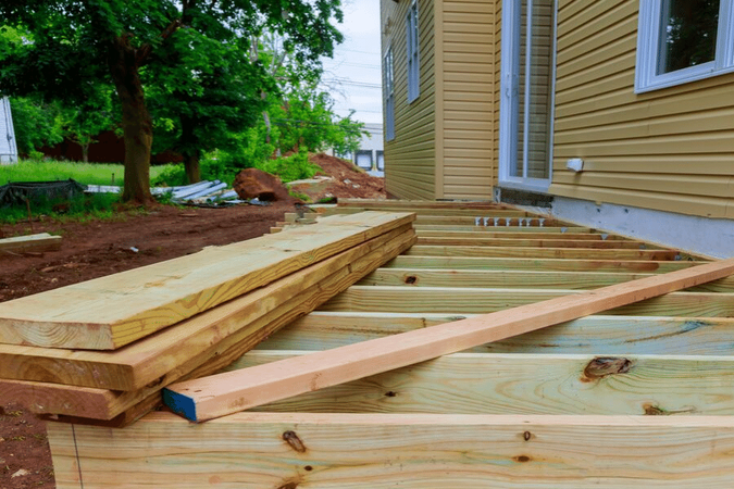 A deck being framed out by a deck builder.